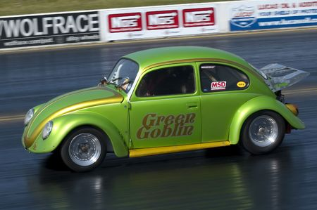 SANTA POD RACEWAY, UK - APRIL 23, 2010: Big Bang Camper and Bus Festival. Street legal Green Goblin VW Beetle on the quarter mile drag strip.
