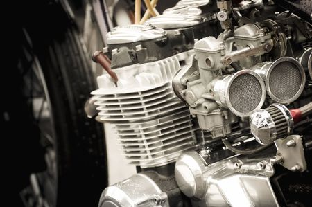 carburettor: powerful motorcycle carburetor and engine parts closeup