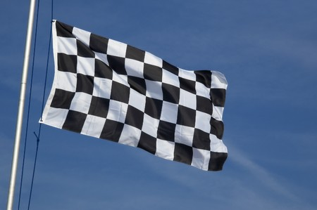 end of race checkered flag waving in the breeze Stock Photo - 6964793