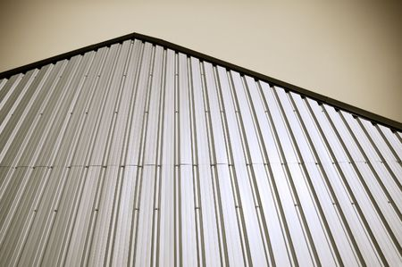 corrugated iron: corrugated metal warehouse facade abstract Stock Photo