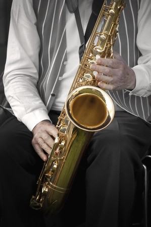 saxophonist playing his instrument in a jazz band photo