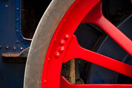 traction: colorful vintage steam traction engine wheel detail
