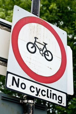 no cycling information warning sign attached to a post photo