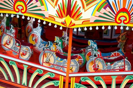 fairground: colorful motorcycle themed vintage fairground ride Stock Photo