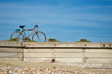 bike on a coastal boardwalk against a beautiful blue sky Stock Photo - 7326264