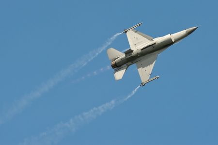 maneuver: Farnborough International Airshow, UK - July 19, 2010: Aerobatic maneuver by a USAF F-16 Fighting Falcon.