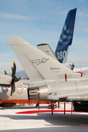 Farnborough International Airshow, UK - July 24, 2010: Military and commercial aircraft tail fins on display.