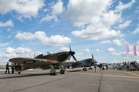 Farnborough International Airshow, UK - July 24, 2010: Spectators flock to see vintage WW2 British fighter aircraft.