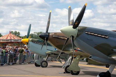 Farnborough International Airshow, UK - July 24, 2010: Battle of Britain rivals, the Messerschmitt BF-109, Hurricane and Spitfire lined up together.