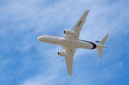 airshow: Farnborough International Airshow, UK - July 20, 2010: Russian developed Sukhoi Superjet 100 passing overhead.