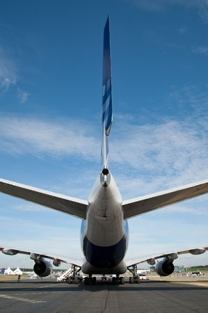 Farnborough International Airshow, UK - July 24, 2010: Wide view of Airbus A380 tail and rudder ailerons.