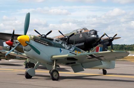 raf: FARNBOROUGH AIRSHOW, UK - JULY 24, 2010: WW2 rivals, the Messerschmitt BF-109 and RAF Lancaster bomber.  Editorial