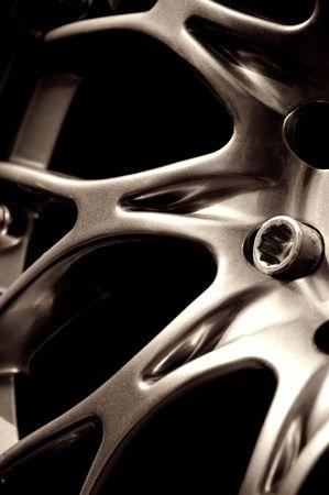 spoked: metallic vehicle wheel hub abstract