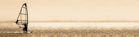 windsurfers: sepia toned windsurfer panorama silhouette