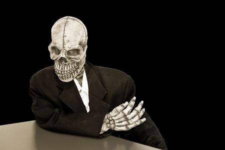 creepy skeleton in a dusty suit on a black background photo
