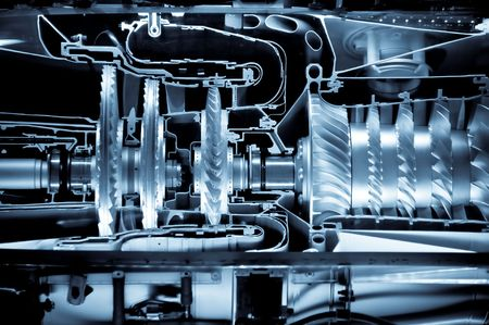 chamber of the engine: jet engine cross section cutaway detail with a blue tint Stock Photo