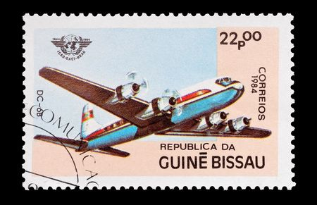 mail stamp printed in Guinea Bissau featuring a vintage DC-6 aircraft, circa 1984