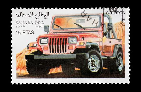 mail stamp printed in Western Sahara featuring an off-road 4x4 vehicle, circa 1992 photo