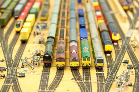 diesel train: collection of model trains in an unfinished replica railroad station Stock Photo