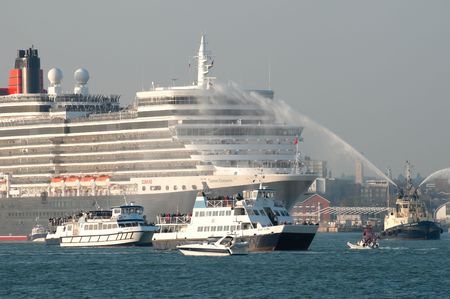 SOUTHAMPTON, UK - OCT 12, 2010: Hazy sunset departure from the Queen Elizabeth ocean cruise liner on her maiden voyage.