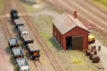 building and freight wagons on a miniature train set - shallow d.o.f photo