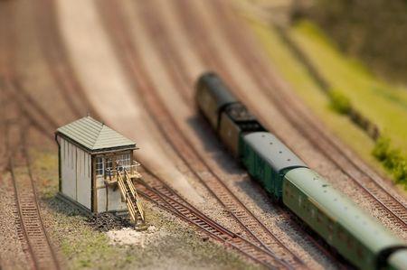 locomotion: signal box and locomotive on a miniature train set - shallow d o f