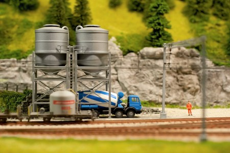 miniature model cement truck loading from track-side silos photo