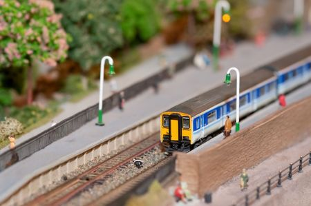 miniature model commuter train in a station with shallow d.o.f photo