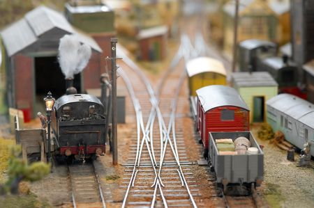 miniature model trains in a freight yard photo