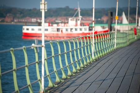 ferryboat: boardwalk railings leading to docked ferryboat