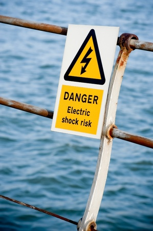 electric shock danger sign on fencing over water Stock Photo - 8356832