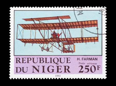 pioneering: mail stamp printed in Africa featuring the pioneering Farman biplane Stock Photo