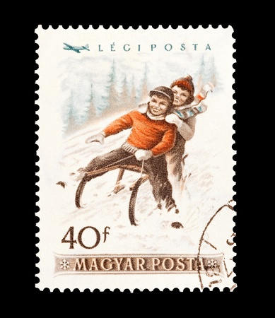 stamp collecting: mail stamp printed in Hungary featuring winter sledging