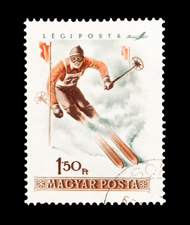 mail stamp printed in Hungary featuring slalom skiing