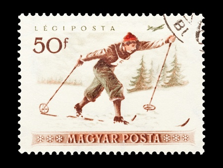 mail stamp printed in Hungary featuring cross country skiing Stock Photo