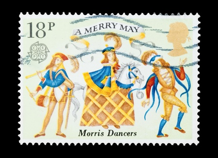 mail stamp printed in the UK featuring traditional May Day morris dancers Stock Photo - 8655378