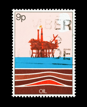 mail stamp printed in the UK featuring an offshore oil drilling rig photo