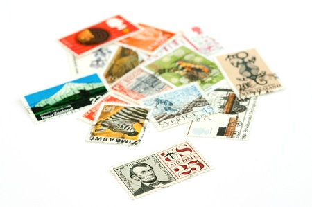 collection of mail stamps with focus on the Abraham Lincoln air mail Stock Photo - 8655384