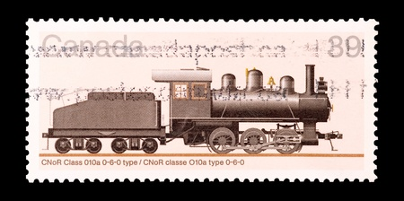 mail stamp printed in Canada featuring a vintage steam train photo