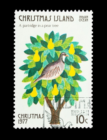12 days of christmas: Christmas Island mail stamp featuring the first gift from the Twelve Days of Christmas