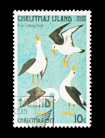 12 days of christmas: Christmas Island mail stamp featuring the fourth gift from the Twelve Days of Christmas Stock Photo