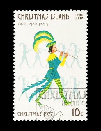 12 days of christmas: Christmas Island mail stamp featuring the eleventh gift from the Twelve Days of Christmas