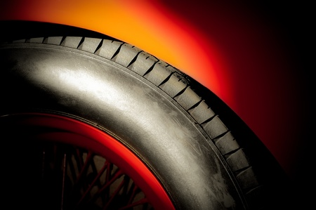 spoked: red sports car wheel and tire in a bright spotlight Stock Photo