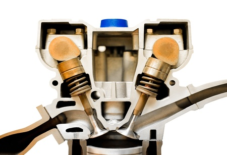 isolated cutaway model of an vehicle engine pistons photo