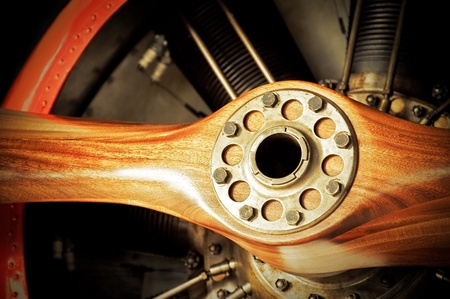 vintage wooden aircraft propeller and engine cylinders