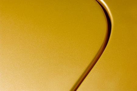 glittering golden vehicle panel abstract Standard-Bild