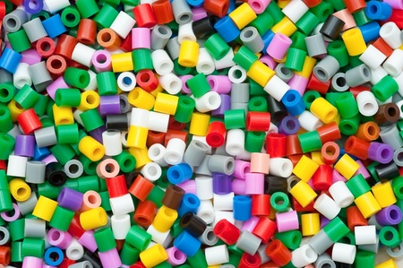 colorful beads: background of multicolored decorative plastic craft beads Stock Photo