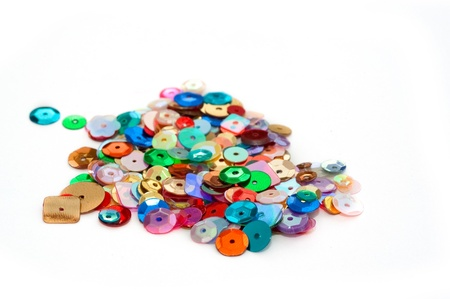 sequins: decorative craft sequins on a white background Stock Photo