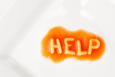 help message written in pasta letters on a white square plate photo