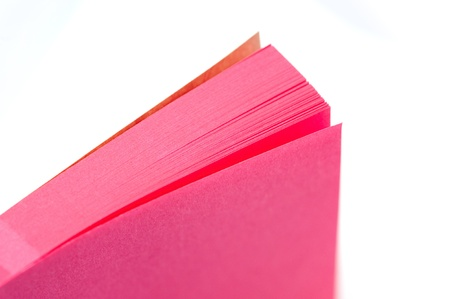 notelet: pink paper memo pad closeup on white with narrow d.o.f